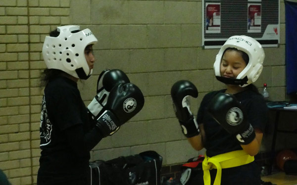 Kung Fu - Light contact sparring to hone skills, timing and accuracy of placement of strikes, whilst covering and fending off strikes